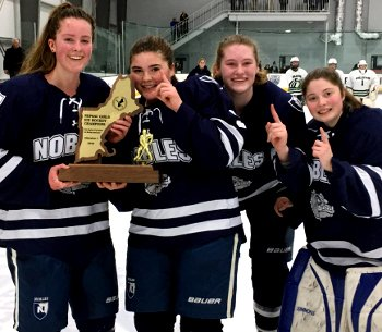The Nobles captains -- Katie Tresca, Abby Volo, Steph Nomicos, and Kelly Pickreign -- celebrate their 2018 NEPSAC Div. I championship.