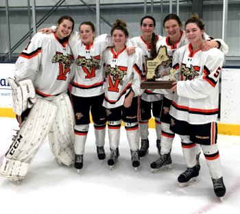 Vermont Academy's captains show off their well-deserved hardware.